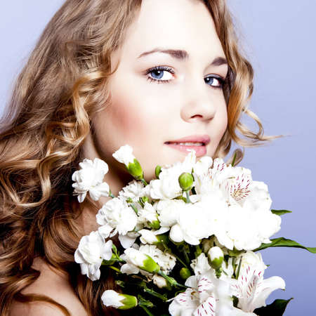 Happy young smiling woman with flowers Stock Photo - 12536362