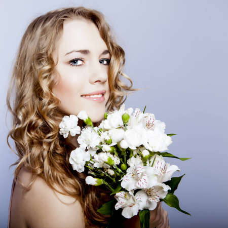 Happy young smiling woman with flowers photo