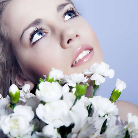 Beautiful and face of woman with flowers photo
