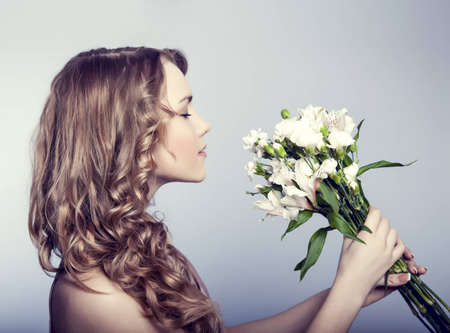Beautiful woman with flowers photo