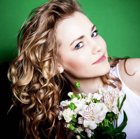 Young Woman with Flowers on a green background Stock Photo - 12534659