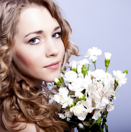 Beautiful young woman with flowers Stock Photo - 12536368