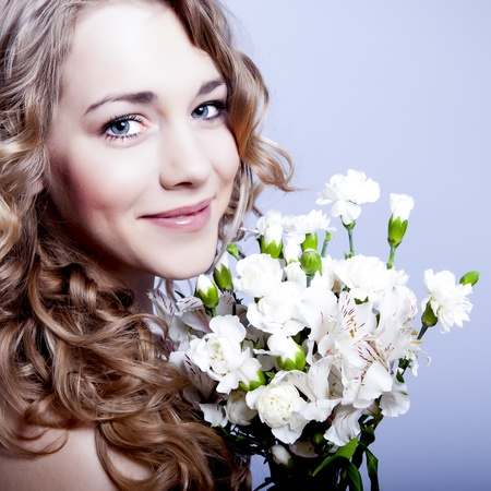 Happy young smiling woman with flowers Stock Photo - 12536367