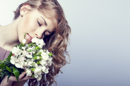 sensual girl with flowers Stock Photo - 12536386
