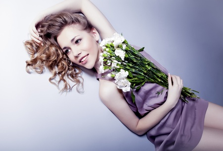 Beautiful young woman with flowers photo