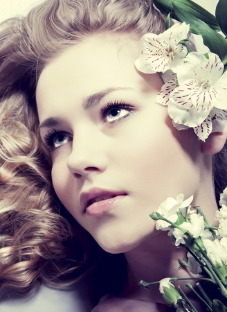beauty close-up portrait young woman face with flowers Stock Photo - 12534694