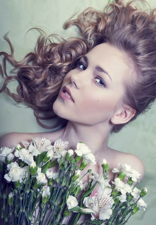 Portrait of romantic girl in flowers photo