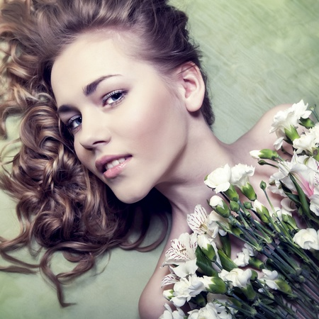sensual girl with flowers photo