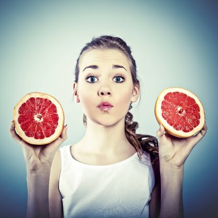 braided hair: portrait of young crazy woman with grapefruit