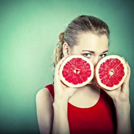 portrait of young attractive woman with grapefruit photo
