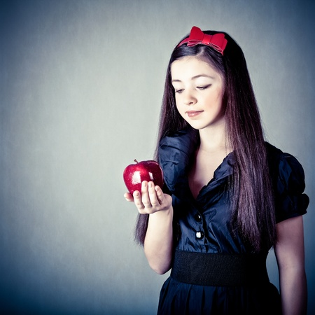 fantasy makeup: fantasy portrait of the beautiful Snow White with an apple