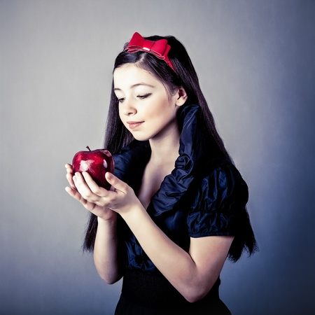 fantasy portrait of the beautiful Snow White with an apple Stock Photo - 12792244