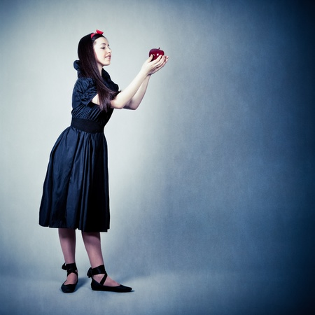 portrait of a beautiful girl with an apple photo
