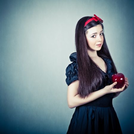 woman apple: portrait of a beautiful girl with an apple