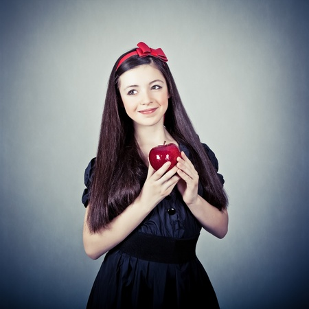 Portrait of a girl, in snow white costume photo
