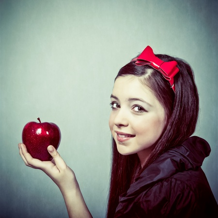 Snow White with an apple photo