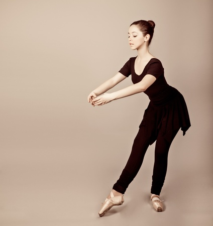 Young caucasian brunette ballerina girl photo
