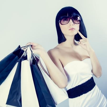 Beautiful girl with shopping bag Banco de Imagens