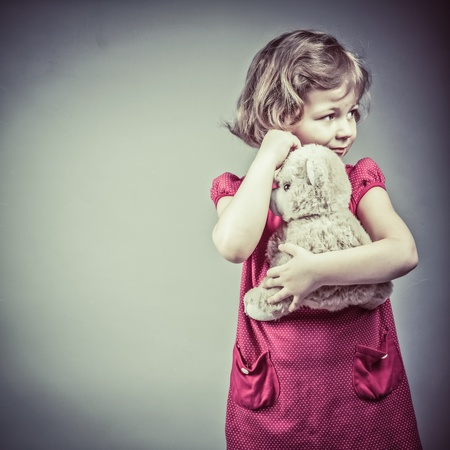 Portrait of little girl with teddy bear photo