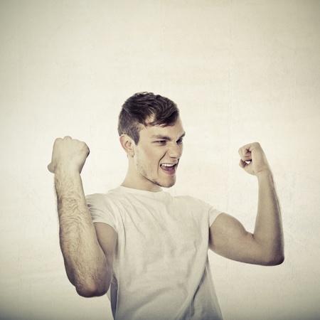 winner man: portrait of young man winner Stock Photo