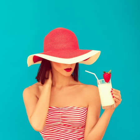 sensual woman with sunglasses drinking a cocktail