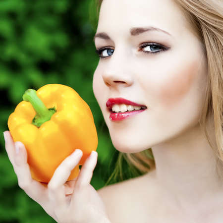 viands: portrait of a smiling girl with pepper Stock Photo