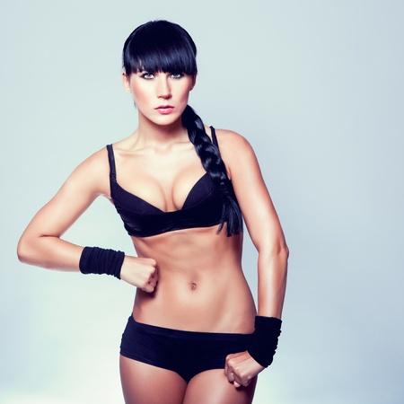 sporty muscular woman photo
