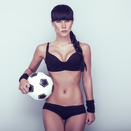 fitness goal: Sports sensual girl with ball