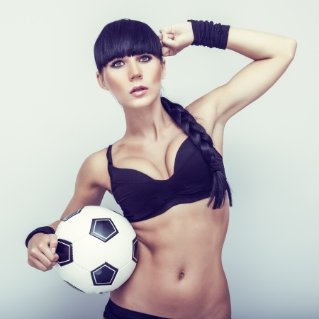 Sports sensual girl with ball photo