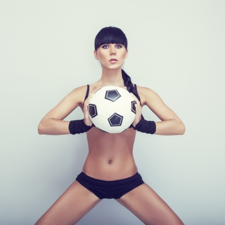 sexy girl posing with ball photo
