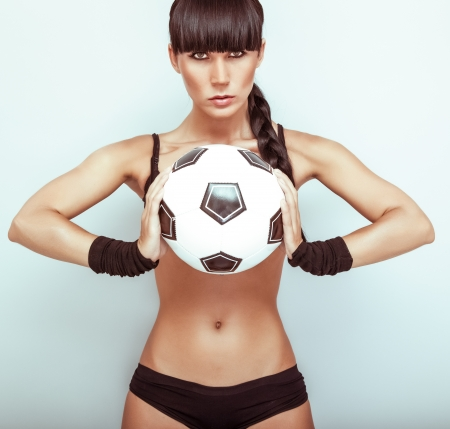 Portrait of a hot young female holding a soccerball photo