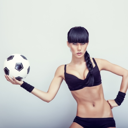 Portrait of a hot young woman holding a soccerball photo