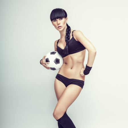 sporty young woman with a ball photo