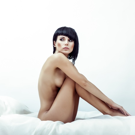 nude female body model: portrait of a sensual girl in white bed