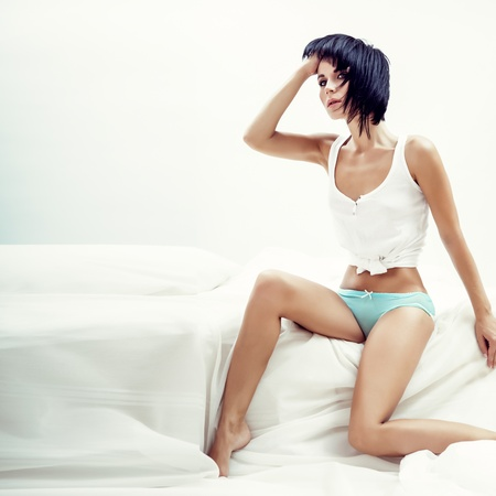 Portrait of sexual girl  in bed Stock Photo
