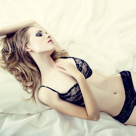 sensual woman sleeping in white bed