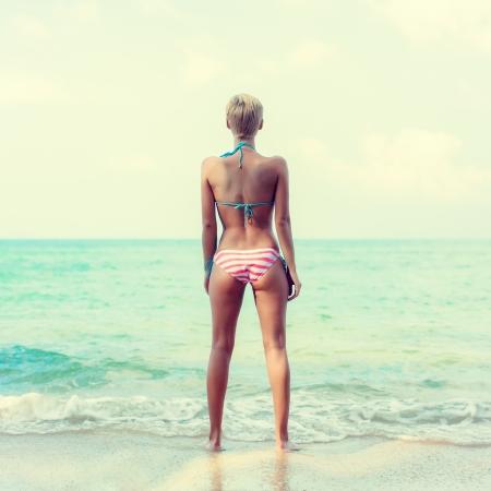 beautiful legs: girl standing on the beach