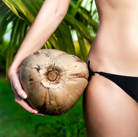 body milk: girl holding coconut closeup Stock Photo