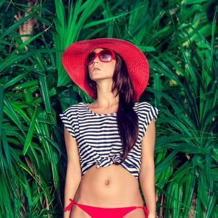 fashion portrait of a woman in a tropical landscape Stock Photo