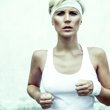 portrait of a young athletic girl running Stock Photo