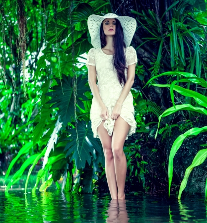 fashion lady in the tropical jungle photo
