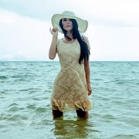 fashion portrait of a girl on the sea Banco de Imagens