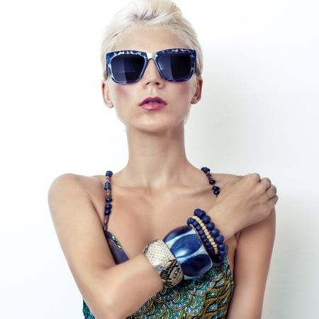 Portrait of sensual woman in fashionable glasses