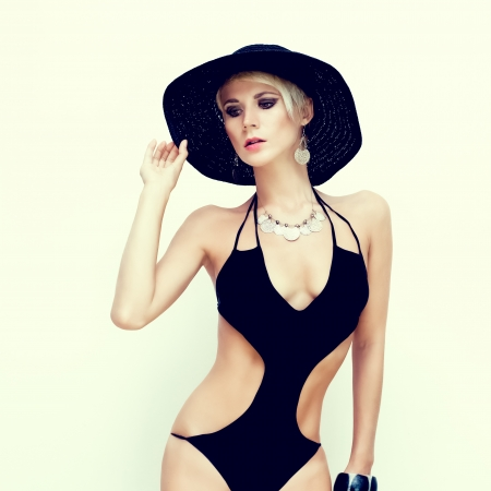 fashion portrait of a sensual girl in a bathing suit photo