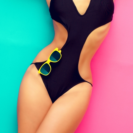 scarf beach: fashion girl in a bathing suit on a bright background