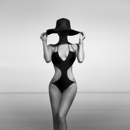 sensual fashion girl on vacation black and white