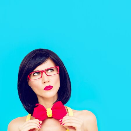 colorful portrait of funny girl on a blue background photo