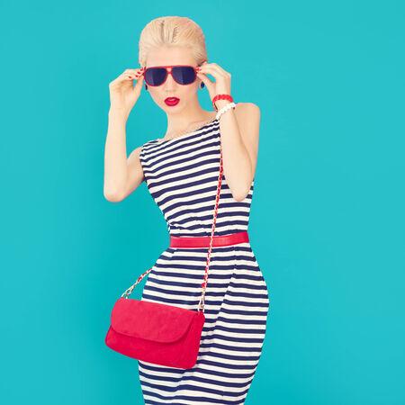Fashion portrait of a stylish girl  Marine style photo