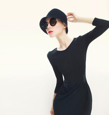 Stylish lady in fashionable hat photo