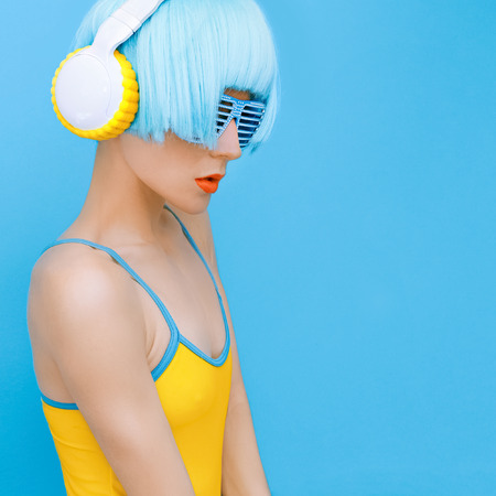 sensual DJ-lady in style headphones listening to music Stock Photo